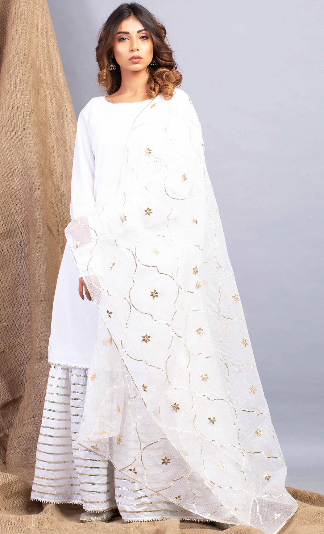 Umrao Noor White Kurta and Sharara Set. Buy Online.