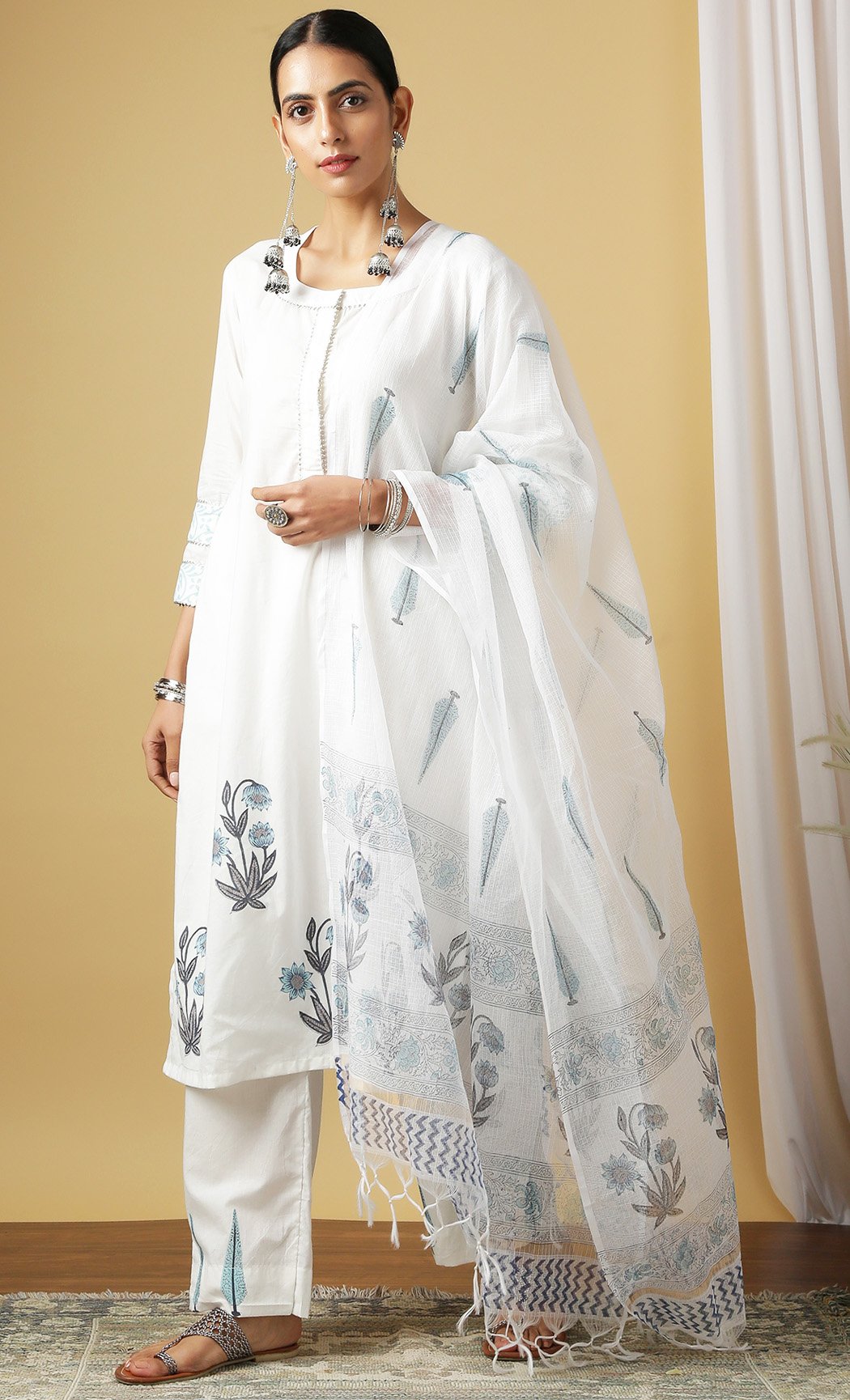 Surajmukhi Neel Ivory Kurta and Pants Set. Buy Online.