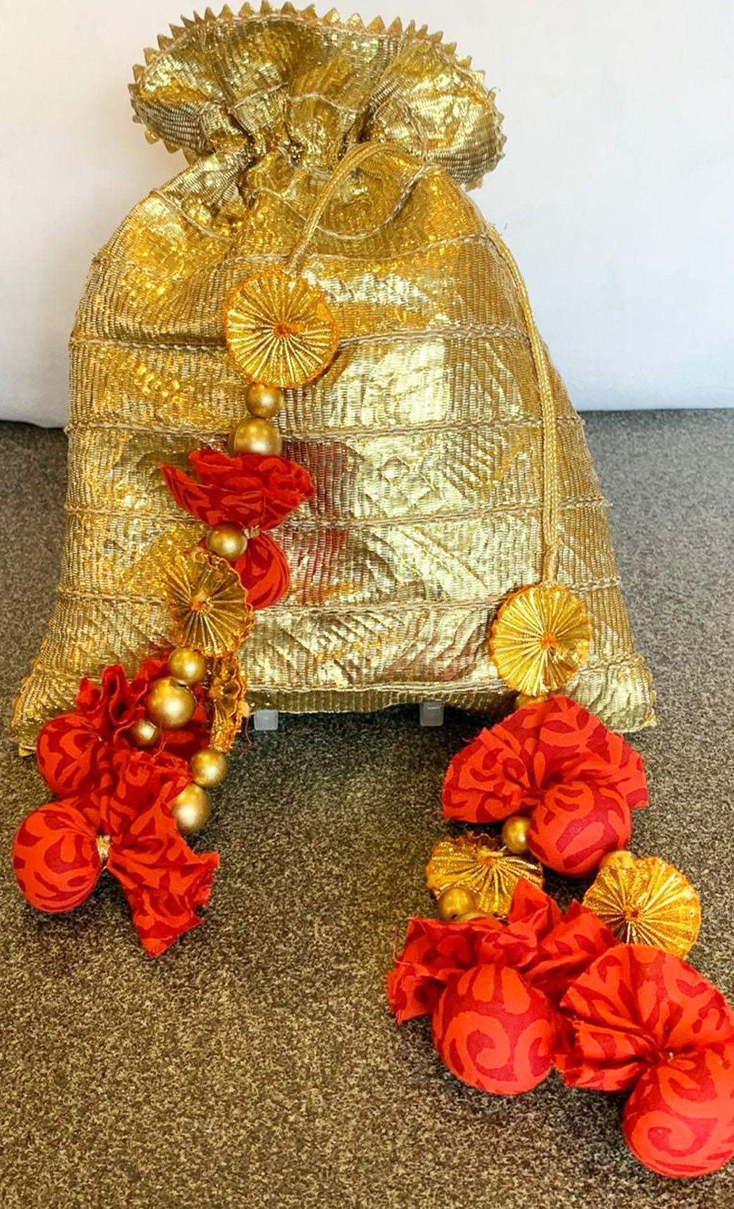 Gold Potli with Batik PomPoms - Buy Online