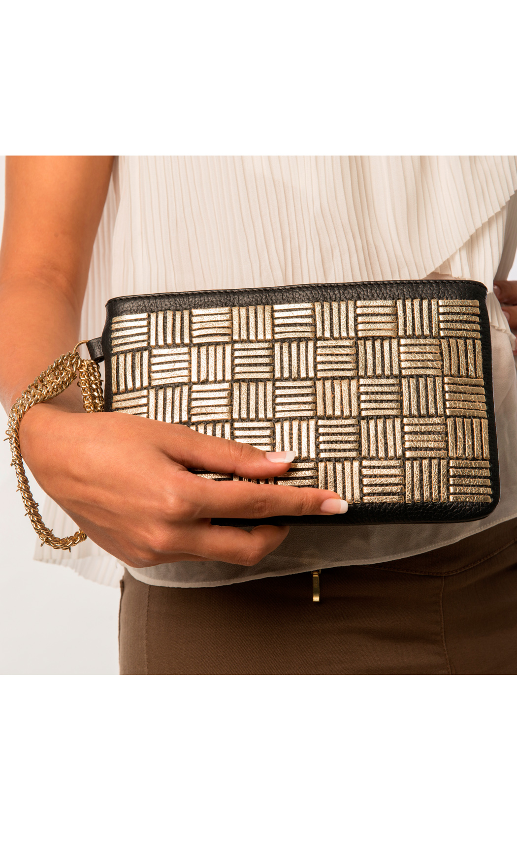 Symphony and Symmetry Two Direction Weave Wristlet in Gold-Black. Buy Online