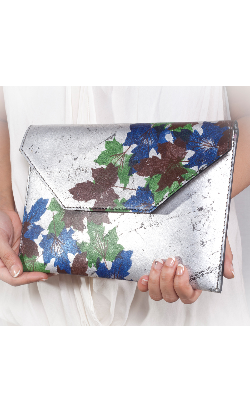 Autumn Scattered Leaf Clutch in Silver. Buy Online
