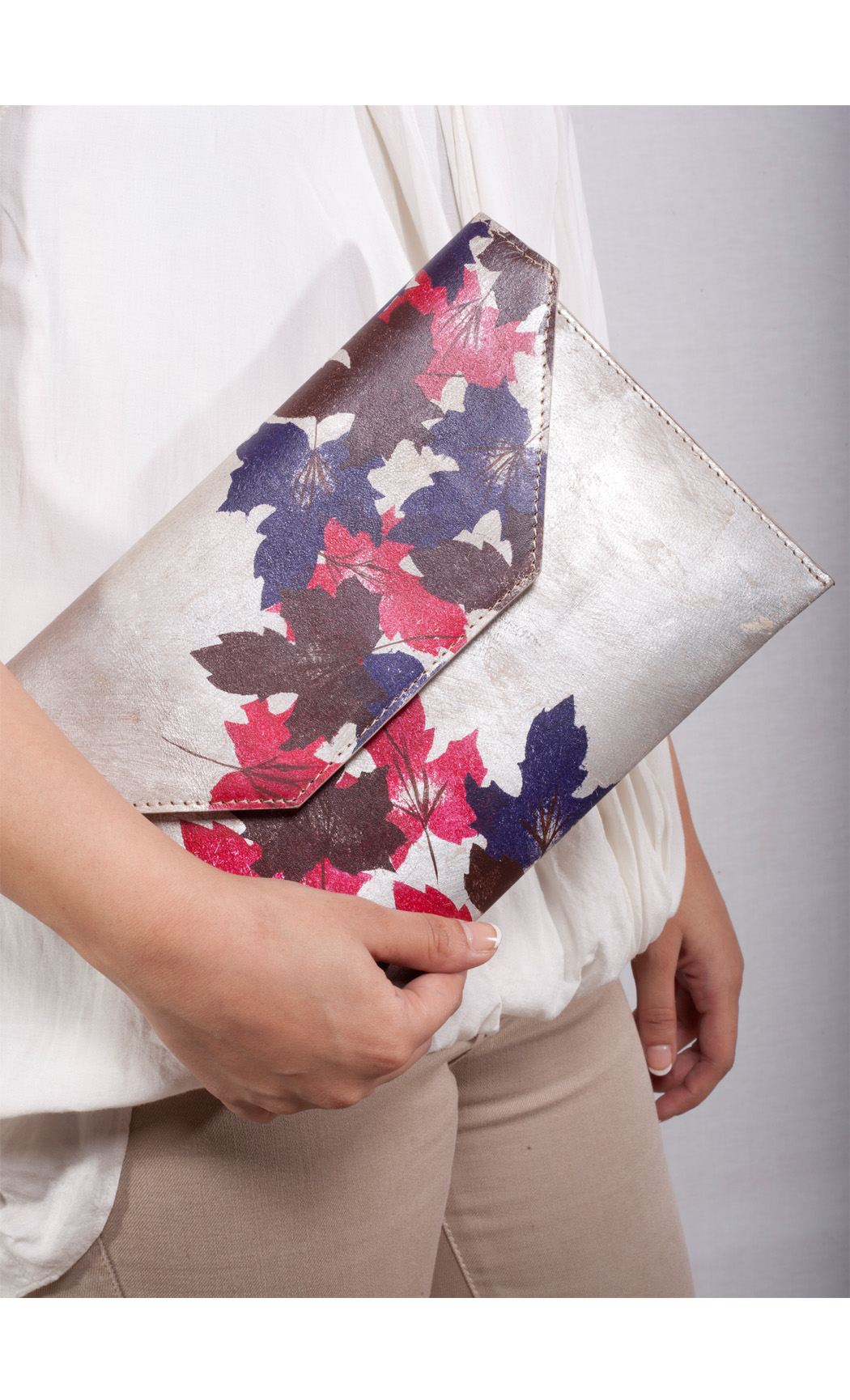 Autumn Scattered Leaf Clutch in Gold. Buy Online