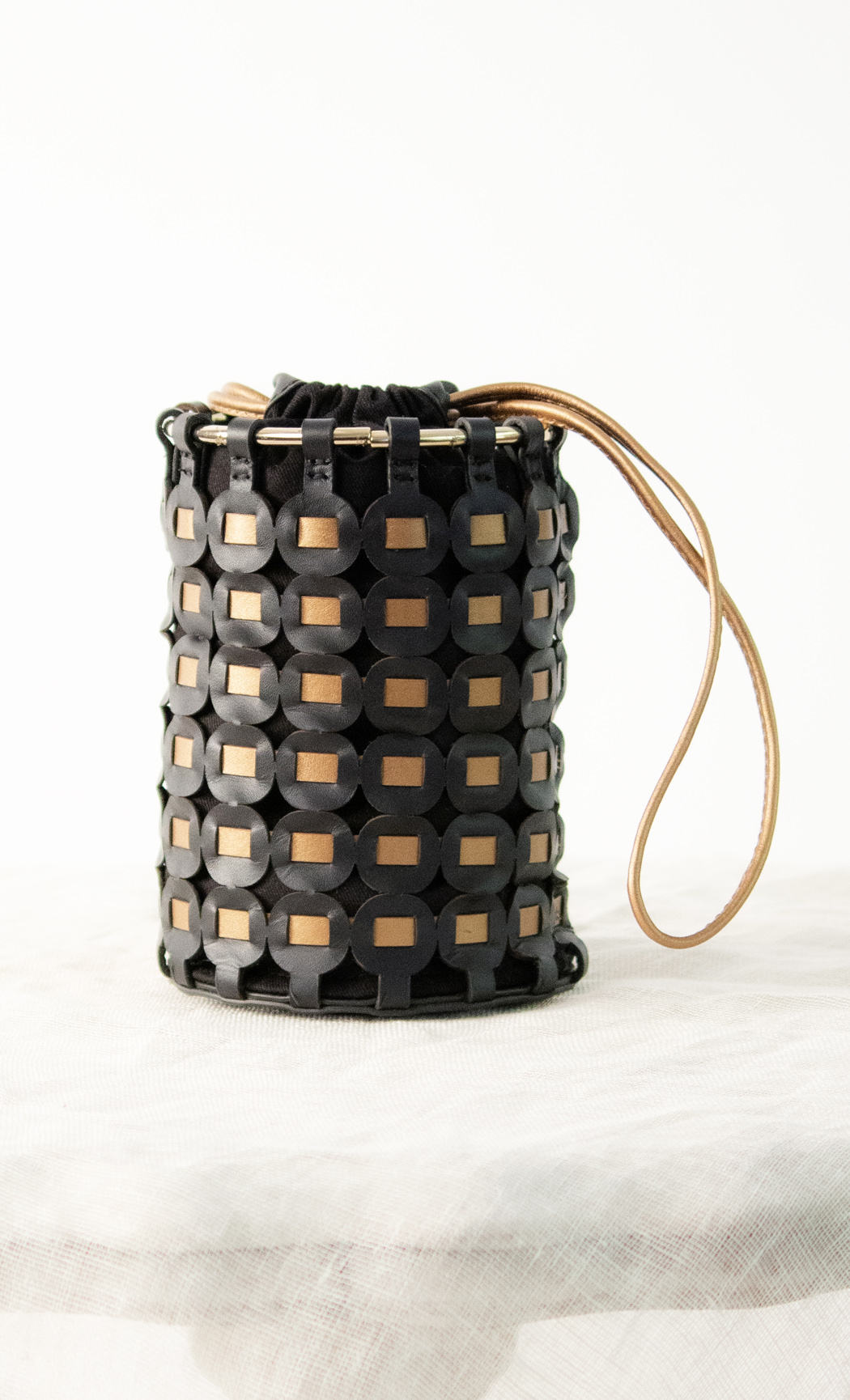 Circle Weave Potli in Bronze-Black. Buy Online