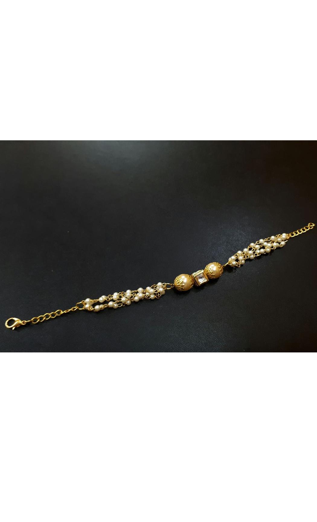 Classic Gold Tone Kundan Inspired Pearl Bracelet Rakhi. Buy Online