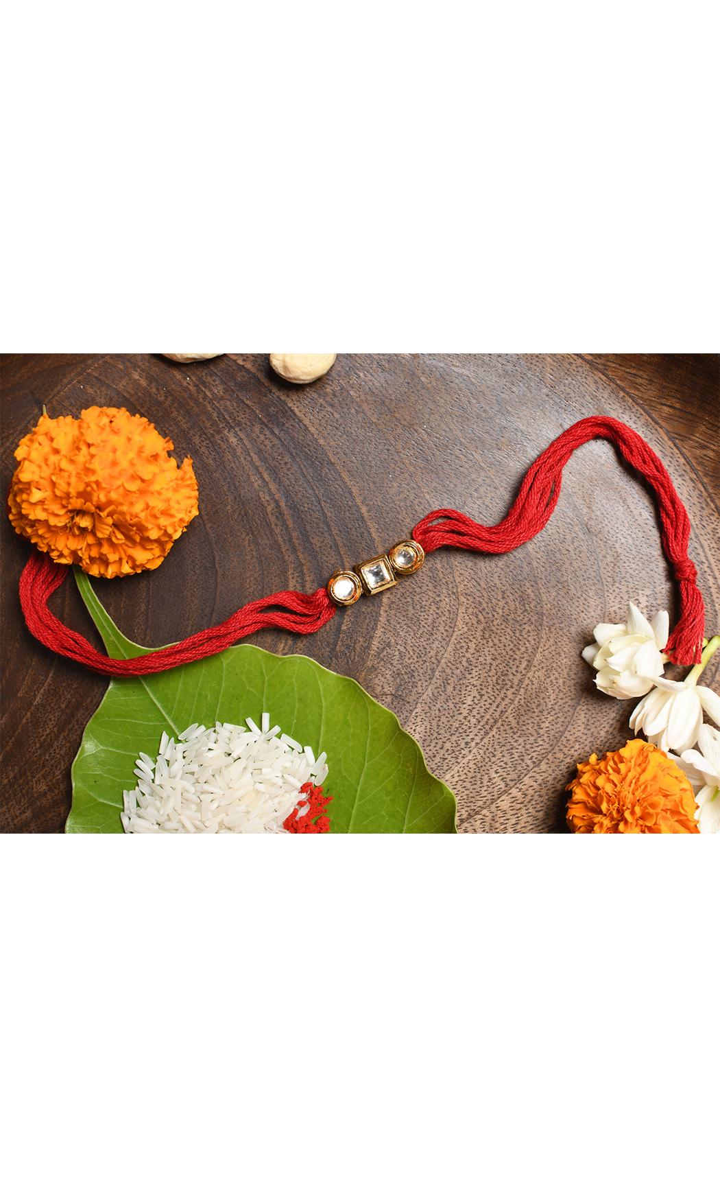Red Gold Tone Kundan Rakhi. Buy Online