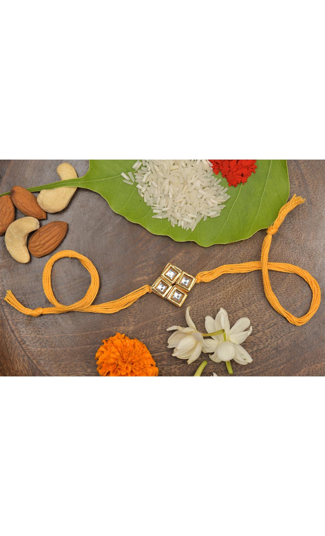 Yellow Gold Tone Kundan Rakhi. Buy Online